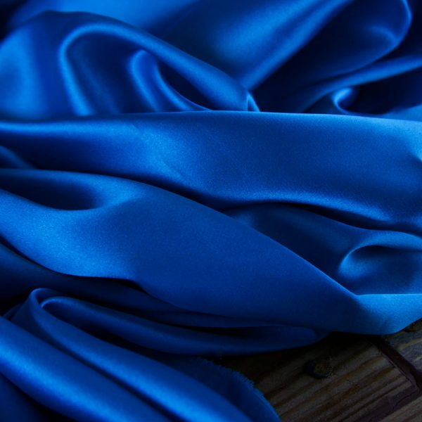 Blue Satin sheets on wood