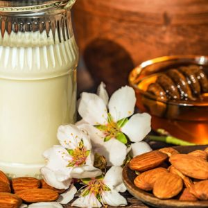 photo of milk jug, honey and almonds