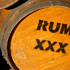 photo of a yellow barrel stamped with a rum marking
