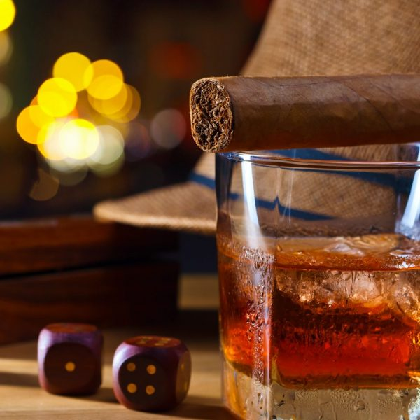 photo of whisky glass, cigar and dice