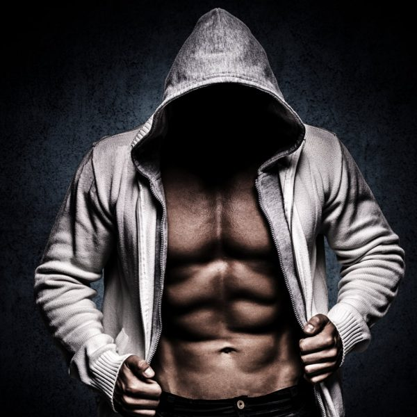photo of a fit man not wearing a shirt but with a hoodie unzipped and hood on