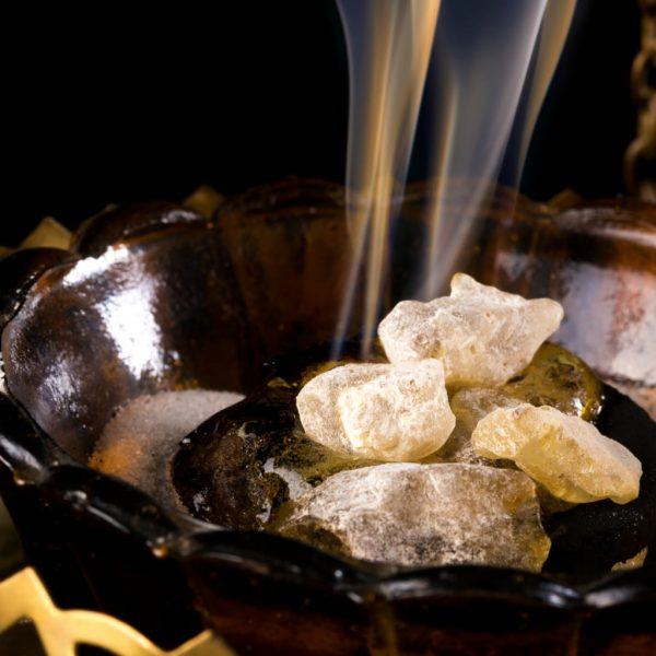 photo of nag Champa burning in a small brown bowl