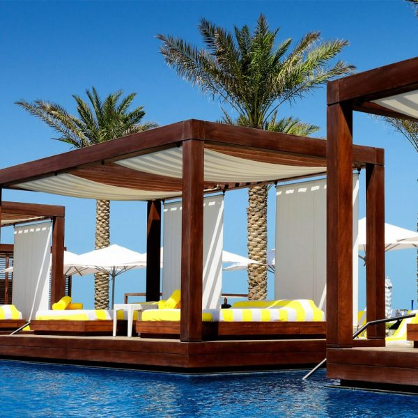 photo of pool side cabanas on a bright sunny day