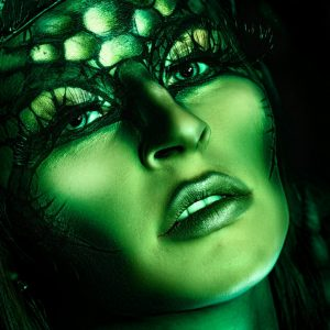photo of a woman with green makeup and mermaid styling