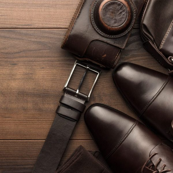 photo of brown suede shoes, belt and wallet