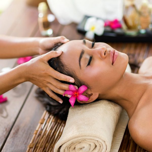 photo of a woman at a spa getting a scalp massage