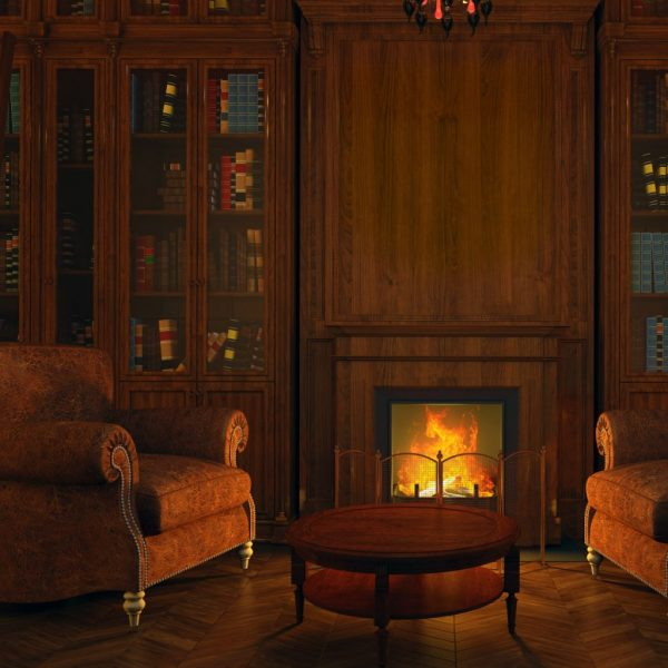 photo of a fireplace with bookshelves, fire and comfy chairs