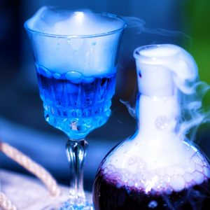 photo of blue and purple potions in glass containers