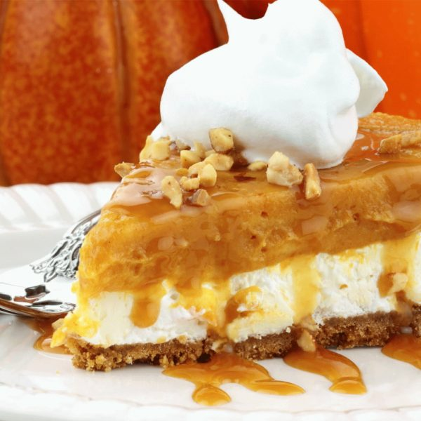 photo of pumpkin pie with whip cream